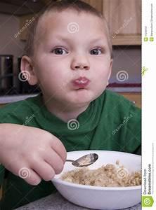 Boy Eating Breakfast Stock Image - Image: 11249151
