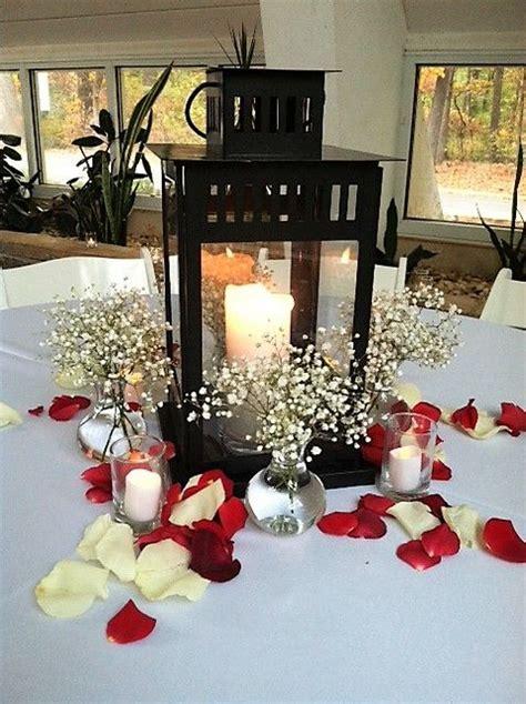 tablescape   black lantern holding  pillar candles