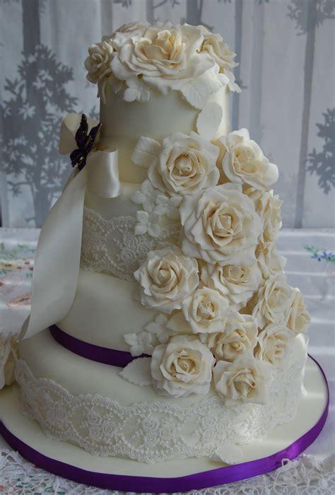 ivory  champagne wedding cake cascading roses  cadb
