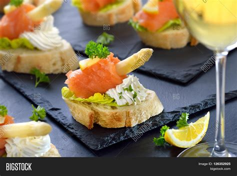 delicious canapes with german white asparagus
