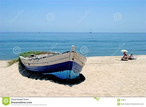 Old Boat On Beach Images by Old Rowing Boat On Sunny White Sandy Beach Stock Image
