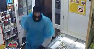 Masked raiders wearing ponchos tie up young shop assistant ...