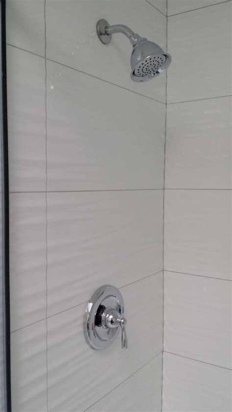 white wavy tile wavy white tiles in shower grey grout bathroom ideas pinterest hardware shower tiles and