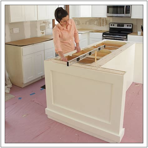 installing a kitchen island how to install kitchen base cabinets bukit build a diy kitchen island running lights in kitchen