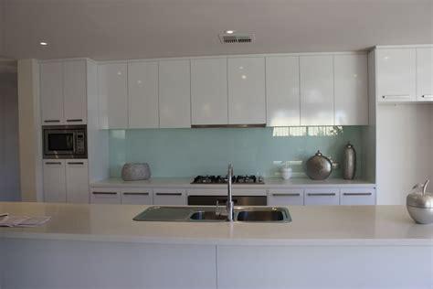 modern kitchen overhead cabinets overhead cupboards and seamless rangehood kitchen ideas