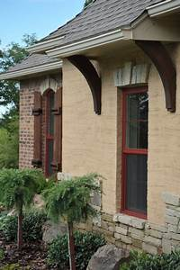 Overhang And Wooden Brackets Stucco Mixed With Brick And