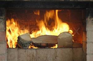 Hot fireplace full of fire wood and fire   Stock Photo ...