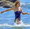 Olivia Wilde frolics in the ocean with shirtless fiance ...