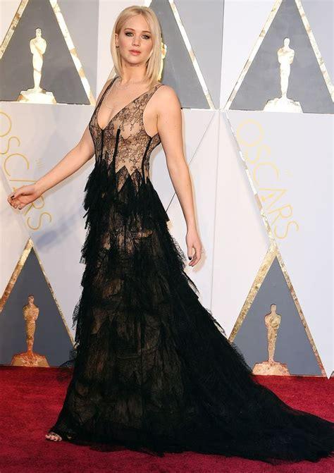 All Of Jennifer Lawrences Oscars Red Carpet Dresses Hair