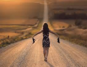 Image result for woman walking long road