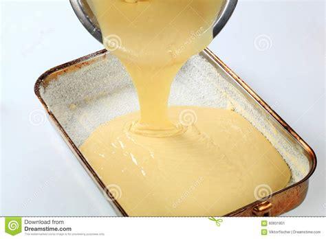 pouring batter  baking pan stock image image
