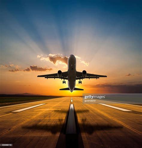passenger airplane    sunset stock photo