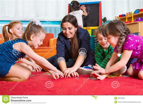 development at kindergarten stock photo image 215 | development games kindergarten children tutor plaing 39419691