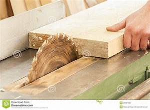 Carpenter Working On Woodworking Machines In Carpe Stock