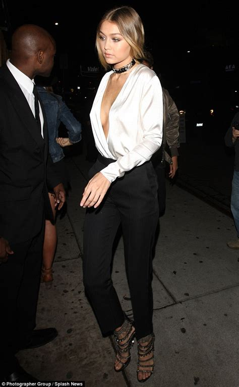 sw blouse hadid gigi hadid bares cleavage in plunging silk top at kendall