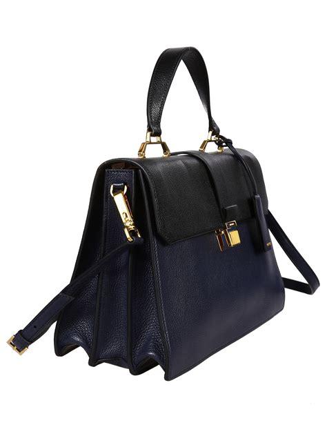 Sepatu Miu Miu 2 miu miu madras 2 pockets medium bag in blue lyst
