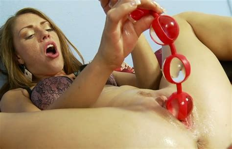 Aroused Lady Scarlett Wild Stuffs Her Snatch With Red Sex Toys