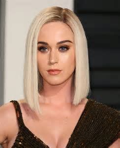 Katy Perry's dress splits in half to reveal her **** in