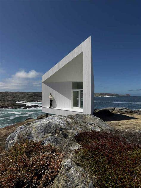 small  modern studio   rocky cliff  ocean view