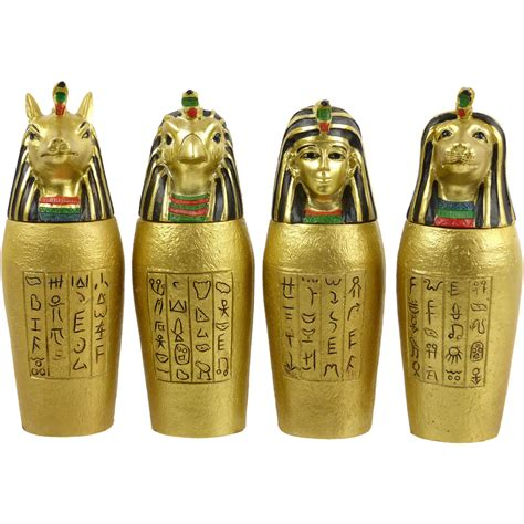 set of 4 gold canopic jars ancient
