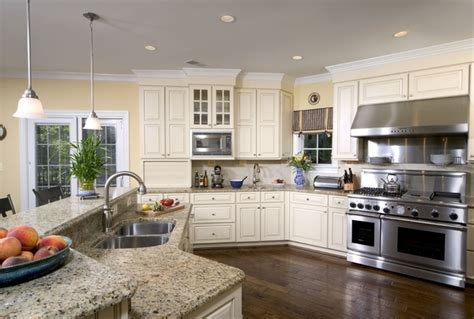 white kitchen cabinets stainless steel appliances santa cecilia granite countertops for a fresh and modern 2058