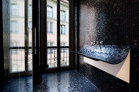 Unique Curved Bathroom Sink With Black Mosaic Tile Skin
