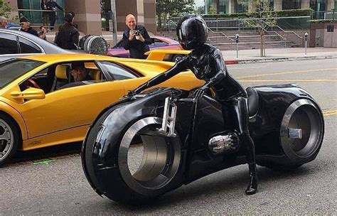 If there's one thing a tech and design writer cannot possibly ignore or resist, it's tron. Tron Legacy Light-Bike Cosplay | Futuristic motorcycle, Tron bike, Futuristic cars