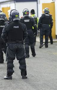 Uk Police Officers In Riot Gear Stock Image