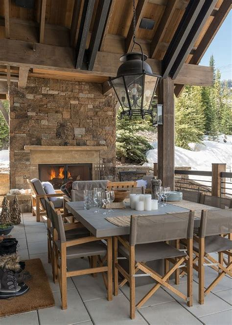 rustic cabin covered patio with square concrete dining