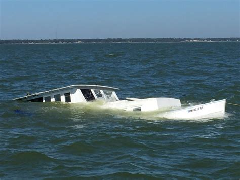Sinking Boat by 3 2 Dogs Saved From Sinking Boat Near Dauphin Island