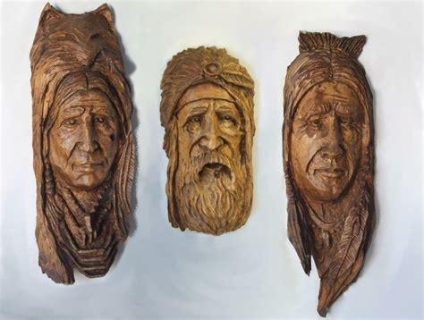 tree carvings faces tree spirits portraits heberts