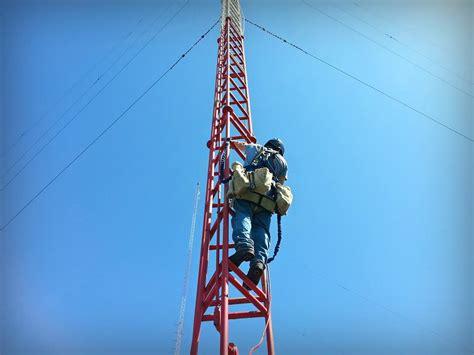 photos radio tower climbers changing light bulbs
