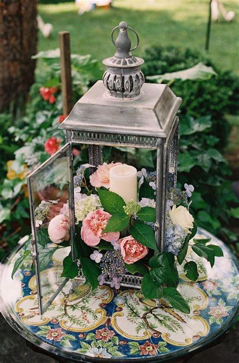 rustic wedding decor ideas flowers in lantern centerpiece