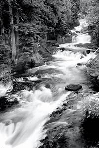 downstream, waterfall, on, black, rocks, during, day, , u00b7, free