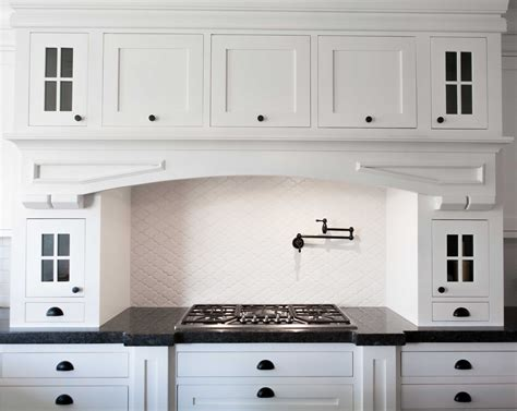 white kitchen furniture the cabinet fronts are called shaker style which is a