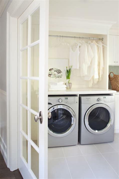 huge laundry room design  silver front load washer