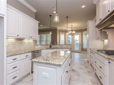 white tile kitchen floor spacious white kitchen with light travertine backsplash 1475