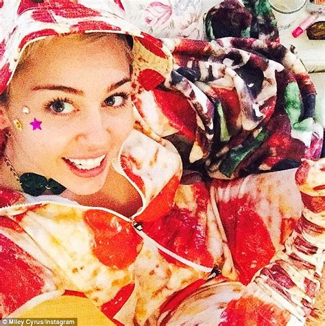 Miley Cyrus chows down on a massive box of pizza during ...
