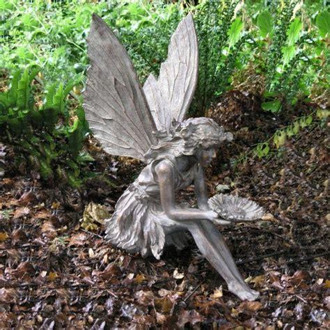 bronze effect sitting flower bronze garden