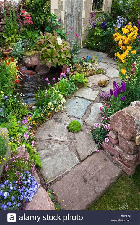 small garden with slabs as the garden path a small pool