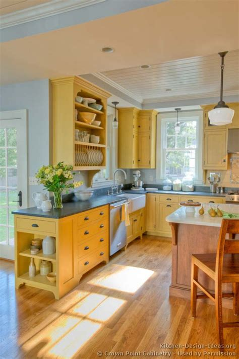 traditional yellow kitchen   custom wood island