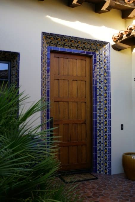 elaborately tiled entrance door frame accents