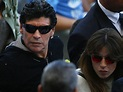 Diego Maradona (L) and his daughter Giannina Maradona leave the stadium during the Argent