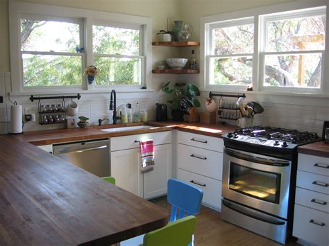 small house kitchen ideas bungalow small kitchen renovation wood counters orb faucet open shelves minimal and