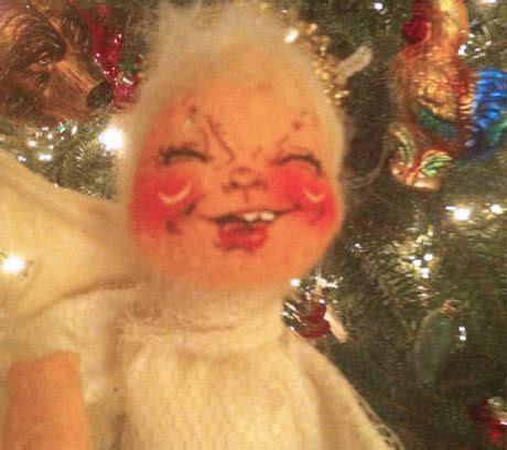 ugly christmas angel   possessed scary