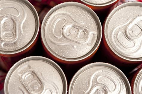 tops  cold soda cans covered  condensation