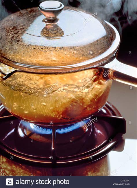 boiling glass water saucepan hob flame gas alamy shopping cart