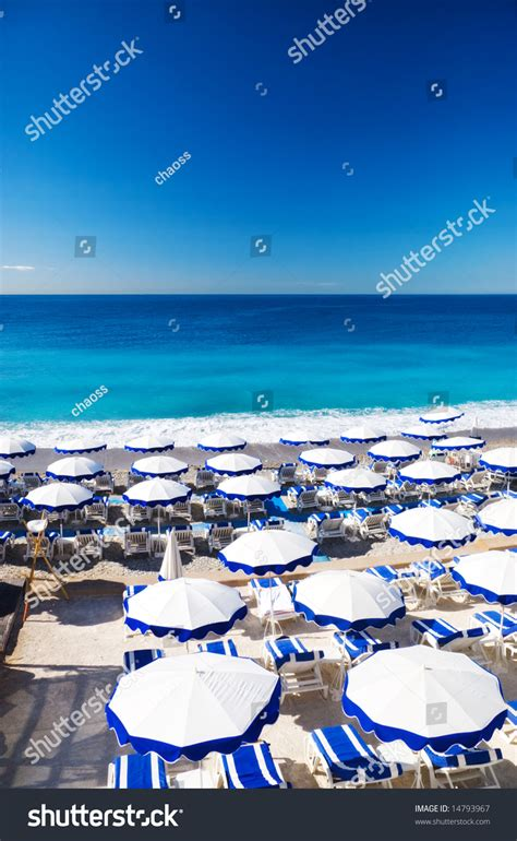 French Beach With Umbrellas Nice France Stock Photo