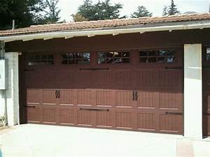 Long carriage style garage doors carriage style garage for Carriage type garage doors