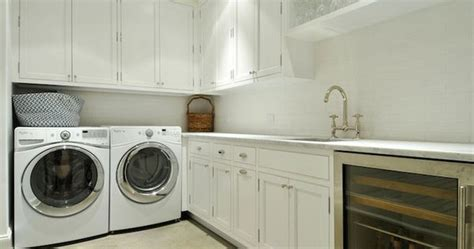 laundry room  butlers pantry combo boasts white shaker